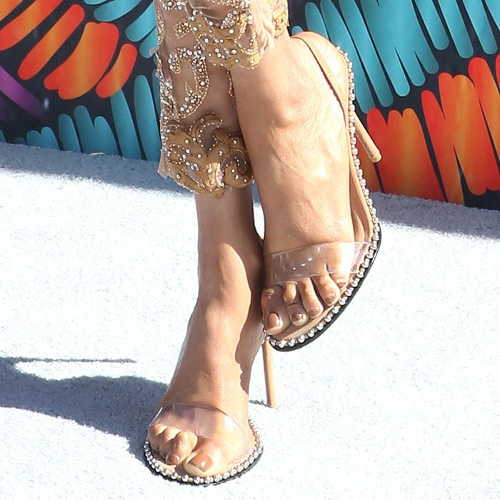 "Tyra Banks showing off her feet in clay suede Alexander Wang ""Nova"" studded slingback sandals"