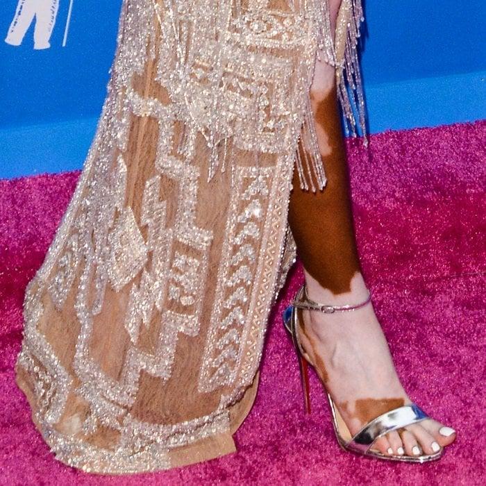 Winnie Harlow shows off her feet in'Loubi Queen' sandals