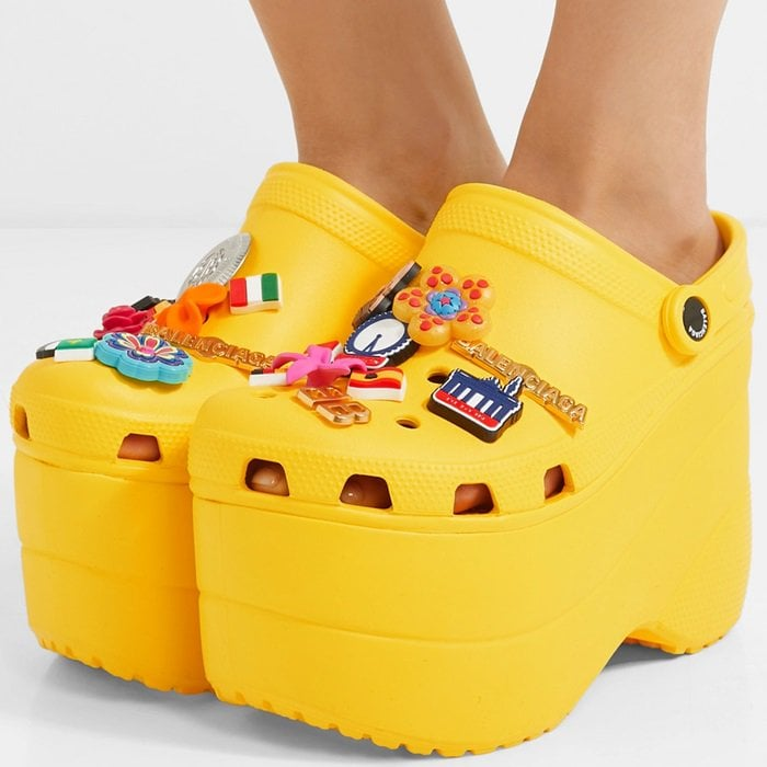 Taking the iconic rubber clog to new heights, this yellow creation is set on a towering platform and decked out with plenty of colorful bling
