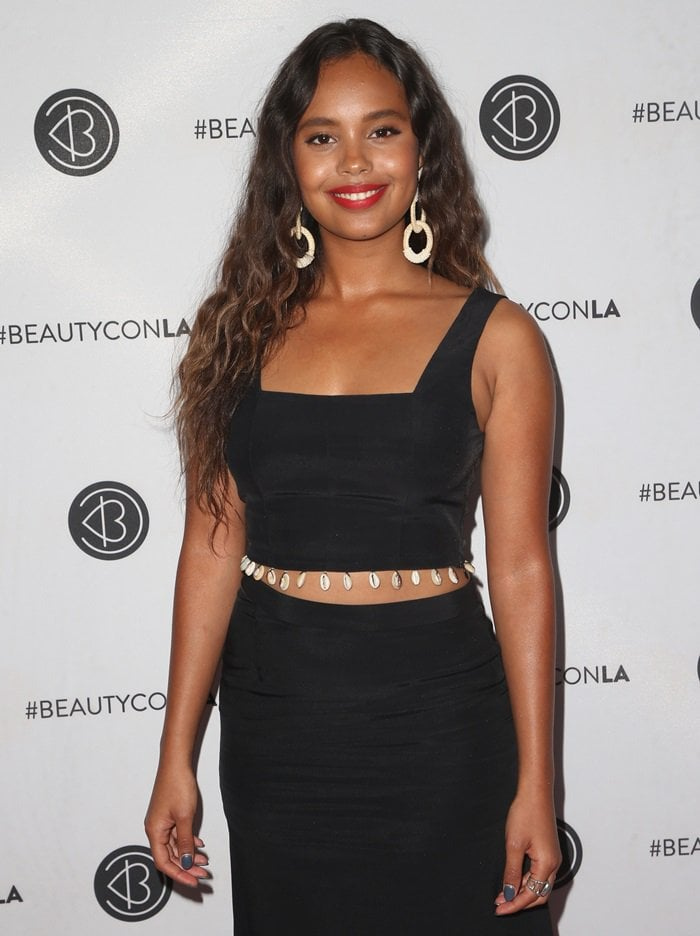 Alisha Boe wearing a black 'Says' cropped shell-embellished cady top while attending the 2018 Beautycon Festival held at the Los Angeles Convention Center in Los Angeles on July 14, 2018