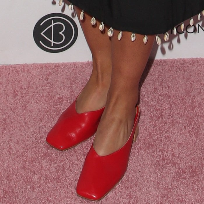 Alisha Boe showing off her feet in red Karen leather mules from By FAR