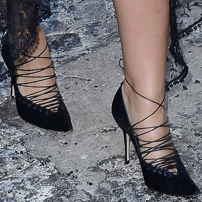 Ashley Graham wearing Jason Wu x Manolo Blahnik Fall 2018 corset lace-up pumps.