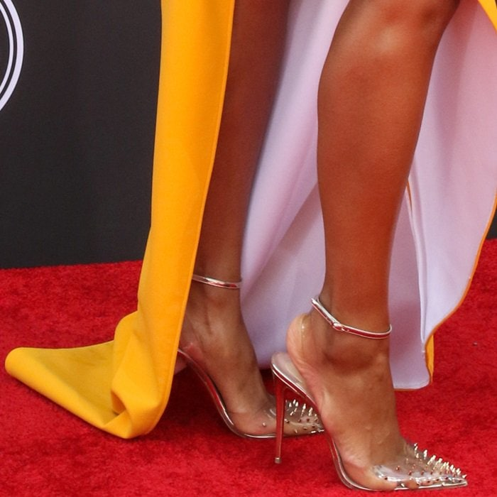 Ciara showing off her feet in edgy studded Spikoo pumps in metallic finish by Christian Louboutin