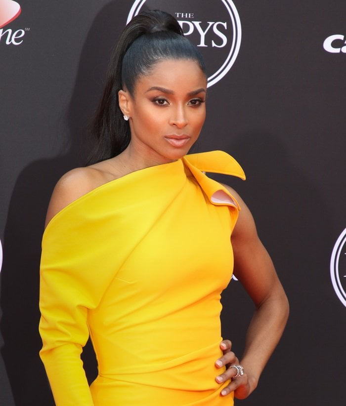 Ciara wearing a sunshine yellow hued 'Mystery' one-shoulder gown from Maticevski's Fall 2018 collection