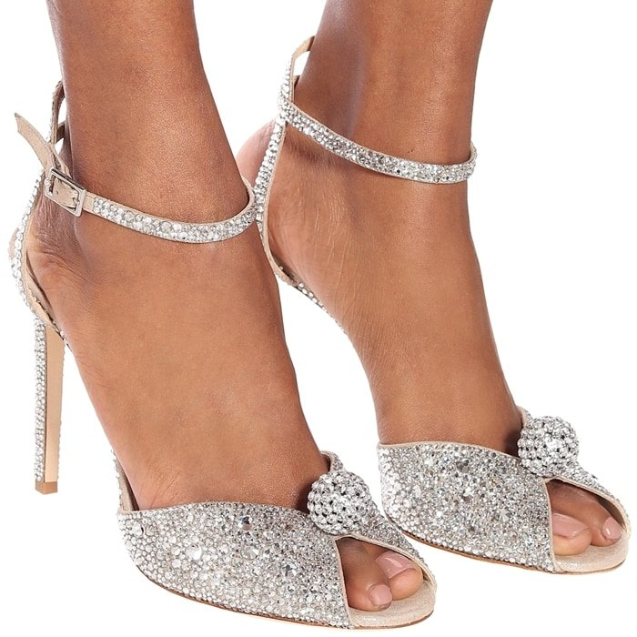 Sacora is a vintage-inspired sandal handcrafted in nude shimmer suede, embellished with a cascade of crystals