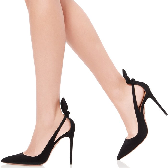 A pert bow perched at the back ties together the chic detailing of a pointy-toe pump featuring side cutouts and a super slim stiletto