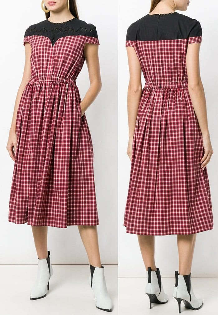 This red and black cotton plaid flared midi dress is a staple piece and features a round neck, short sleeves, a plaid print, a fitted waist, a mid-length and a flared style