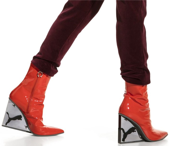 Opened up by iconic FENTY horseshoe pullers, the full length side zip makes it easy to get into those spectacular boots