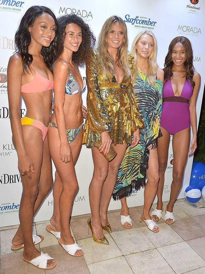 Heidi Klum with models wearing her latest Heidi Klum Swim collection.