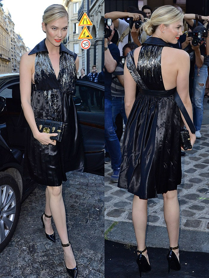 Karlie Kloss in a Louis Vuitton Fall 2018 beaded black-satin halter dress and double-ankle-strap black-patent pumps.