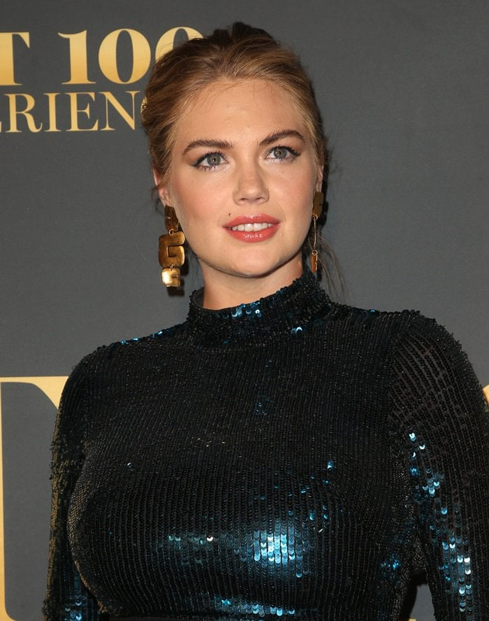 Kate Upton wearing a custom figure-hugging Temperley London sequin midi dress