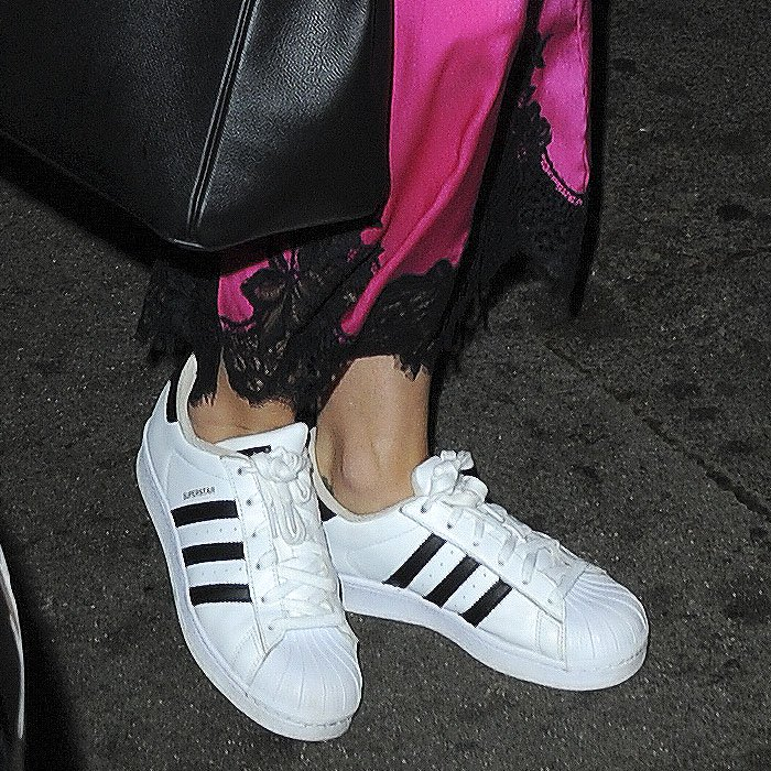 "Closeup of Katy Perry's Adidas Originals ""Superstar"" sneakers."