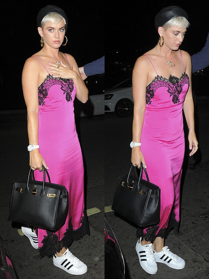 "Katy Perry wearing a pink slip dress with black lace and Adidas ""Superstar"" sneakers."