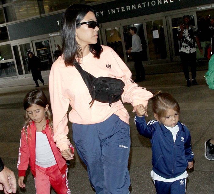 Kourtney Kardashian at Los Angeles International Airport (LAX) with her children on July 9, 2018