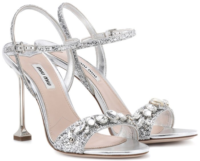Resting on a sculptural heel, the thin toe band and dainty ankle straps have been decorated with dazzling crystals