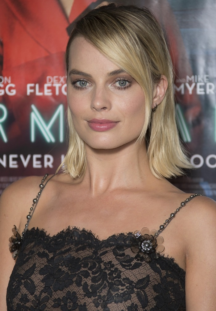 Margot Robbie posing for photos at a screening of her movie Terminal in London, England, on July 5, 2018