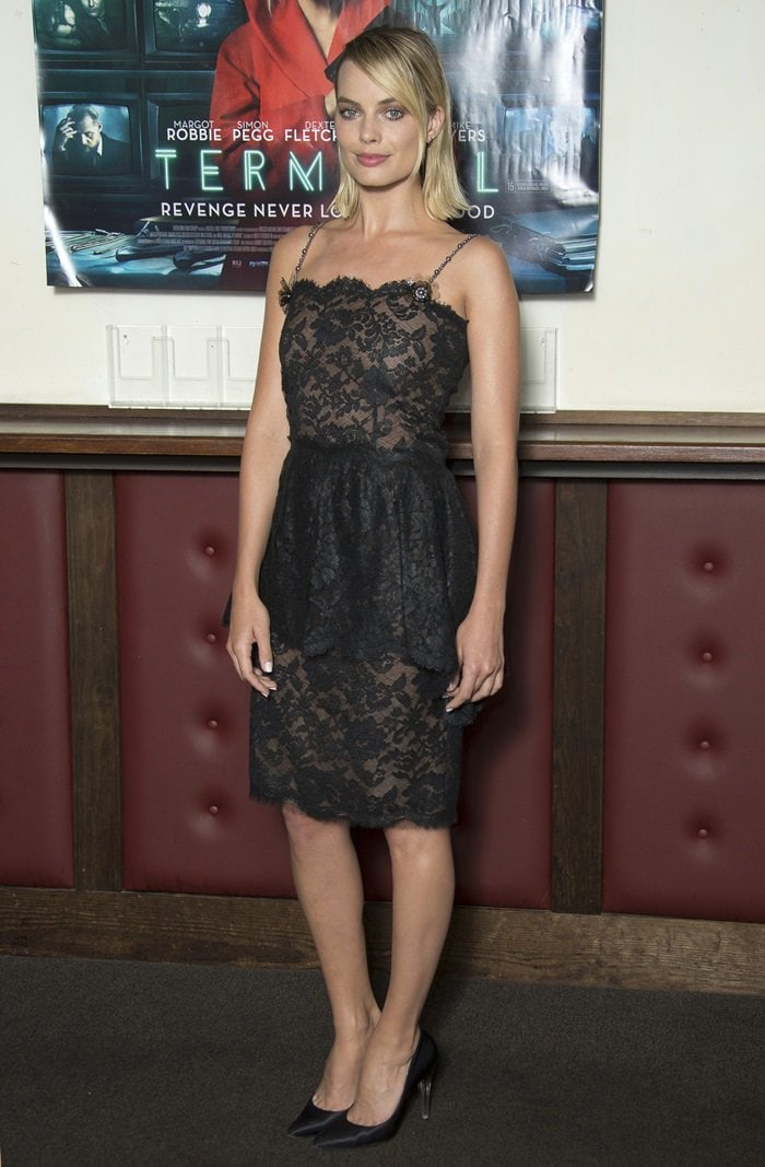 Margot Robbie showed off her sexy legs in a black lace dress with beaded spaghetti strap detailing and nude illusion panels from the Chanel Fall 2018 Collection