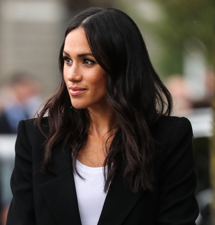 Meghan Markle wearing a black cropped double-breasted blazer by Givenchy