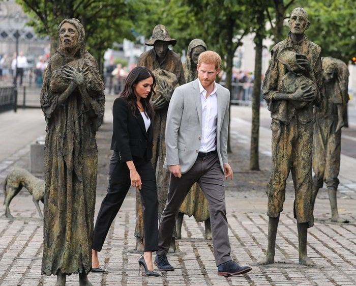 Meghan Markle and Prince Harry visiting the Famine Memorial in Dublin
