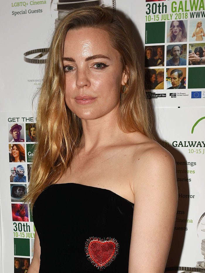 Melissa George in a strapless black-velvet top with a beaded red heart embellishment