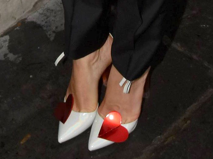 Melissa George's sexy feet in white-patent ankle-tie pumps with red hearts and red-tinted chunky clear heels