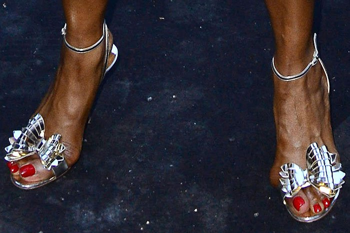 "Naomi Campbell's bunions pushing out of Christian Louboutin ""Miss Valois"" bow sandals."
