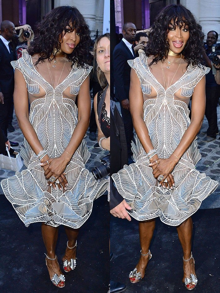 "Naomi Campbell in an Iris van Herpen Fall 2018 Haute Couture sculptural dress and Christian Louboutin ""Miss Valois"" bow sandals."