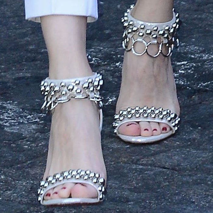 "Olivia Palermo shows off her feet in Christian Louboutin ""Gypsandal"" sandals with metal ball studs and O-ring trim"