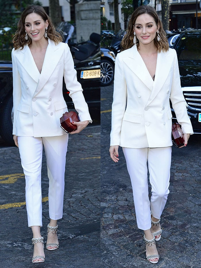 """Olivia Palermo in a Max Mara white pantsuit and Christian Louboutin """"Gypsandal"""" heels."""