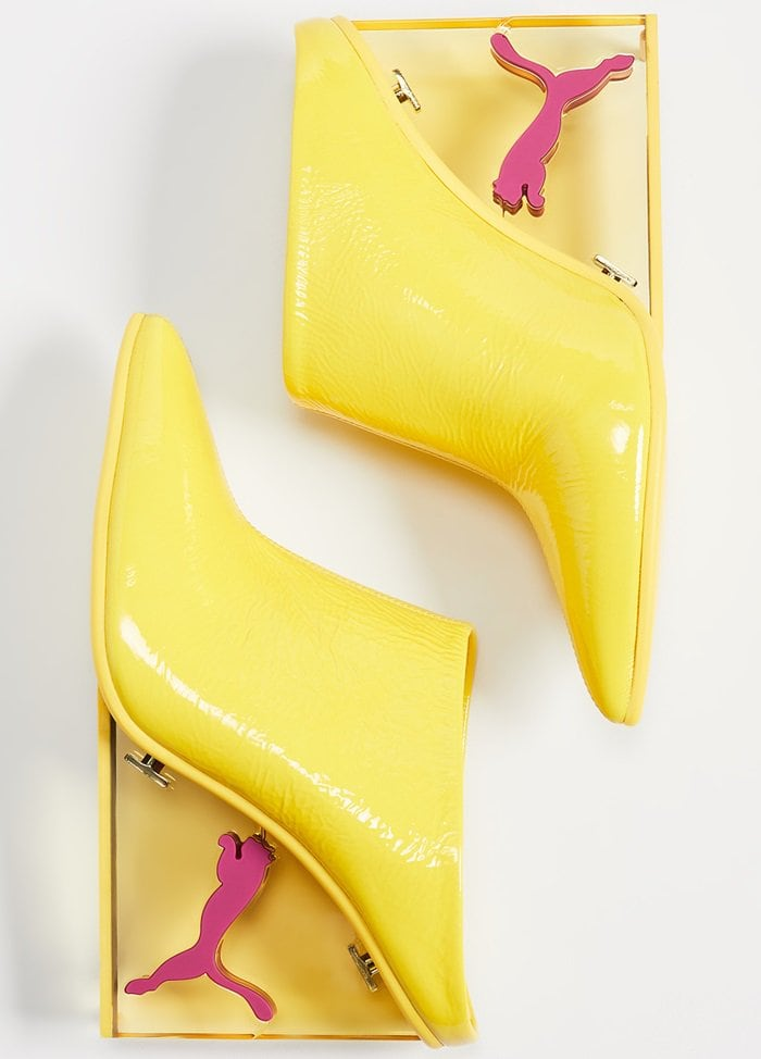 Flaunt your fierce yet feminine style in these blazing yellow slip-on mules channeling sporty glamour