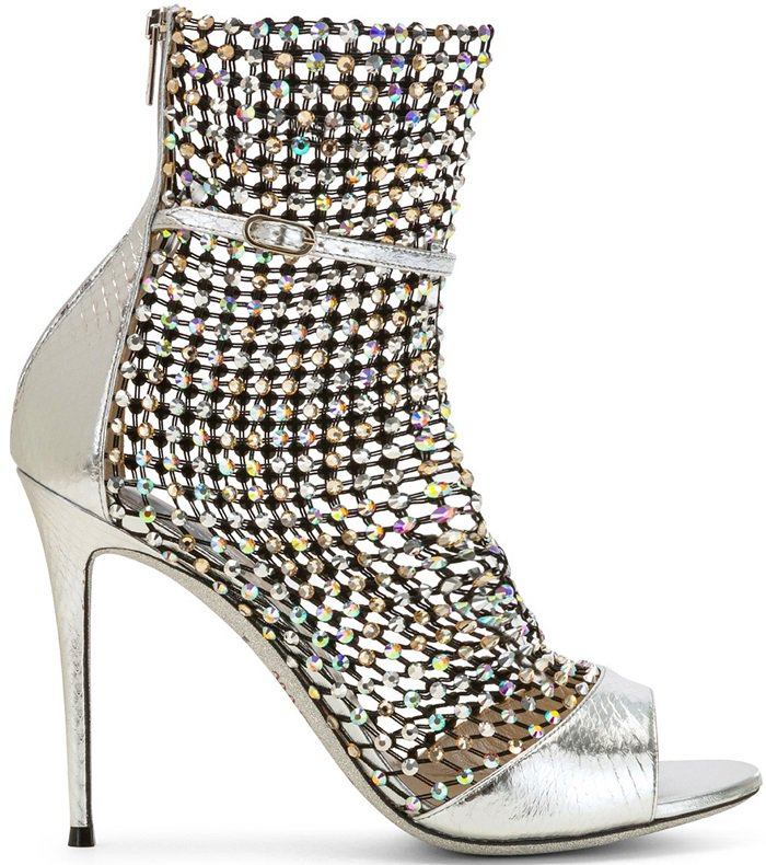 The contemporary mesh offers a striking contrast to the crystal embellishments