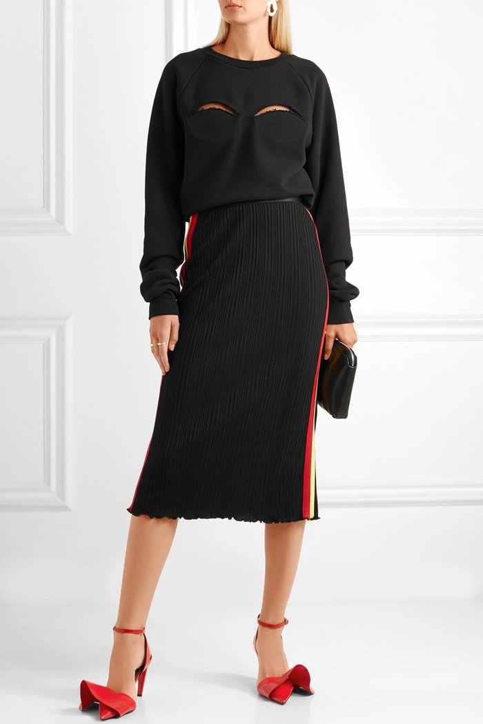 Model wearing a 'Dasha' striped ribbed-knit midi skirt fromEllery's Pre-Fall '18 collection and a matchingcutout cotton-blend jersey sweatshirt fromMaison Margiela