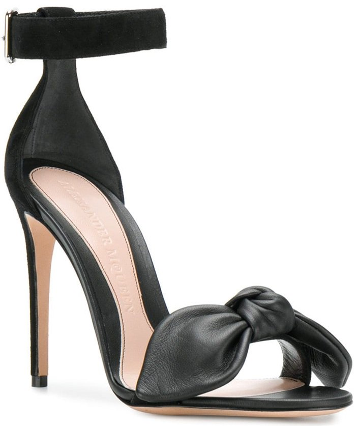 These black leather and suede bow detail stiletto sandals feature an ankle strap with a side buckle fastening, a high stiletto heel, a bow detail, an open toe and a brand embossed insole