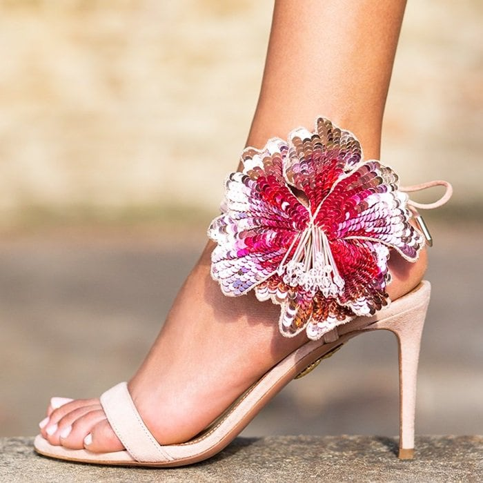 This mid-heel pair features an elegant open toe and soft laces that tie at the back to secure a perfect fit