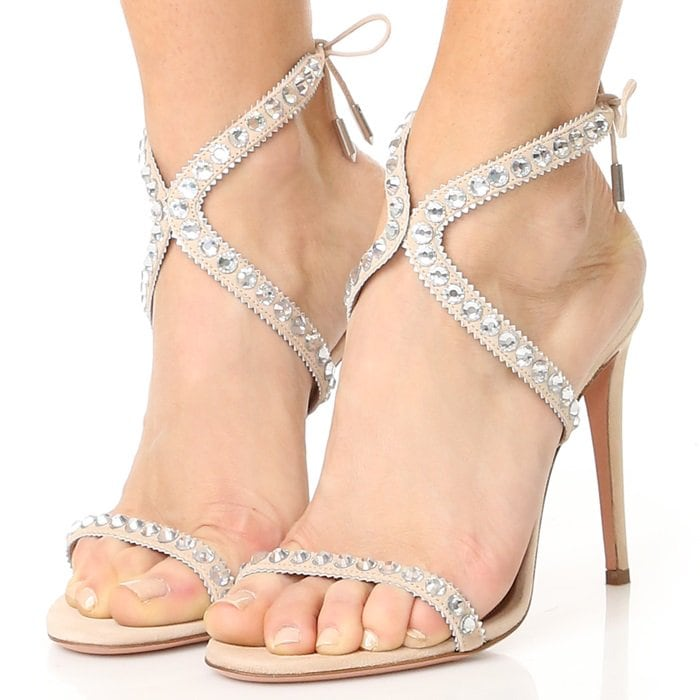 Rhinestones and metallic zigzag trim accent the slender, sinuous straps on these nude leather Aquazzura sandals
