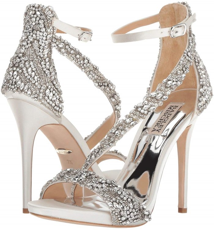 Placed crystals dazzle on a soaring satin sandal styled with curvy, dramatic straps and outfitted with a cushioned footbed for dancing the night away.