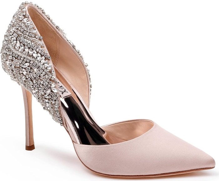 Placed crystals dazzle across the back of an arch-baring d'orsay pump lifted by a soaring stiletto heel.