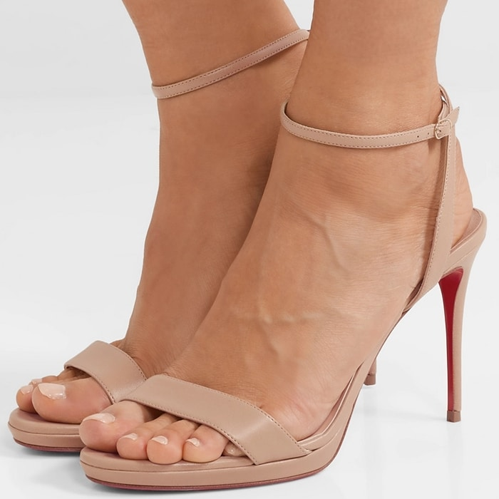 The design has been crafted in Italy from buttery lamb leather in a versatile beige hue, and features a thinly strapped upper set on a 100 mm stiletto heel