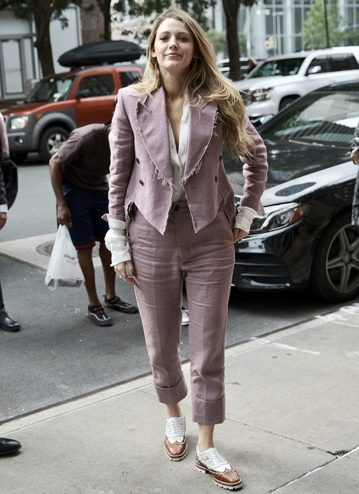 Blake Lively wearing a matching pant and blazer ensemble from Vivienne Westwood's Fall 2018 RTW Collection