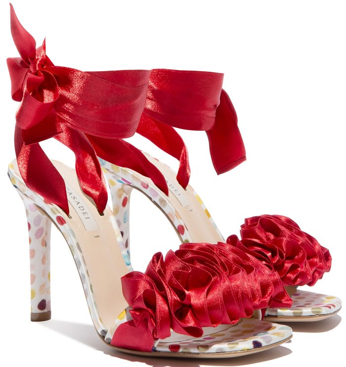 Ruffled colored satin adorns the luxurious upper of these summer sandals, while satin straps wrapped around the base of the shoe and the ankle ensure the fit