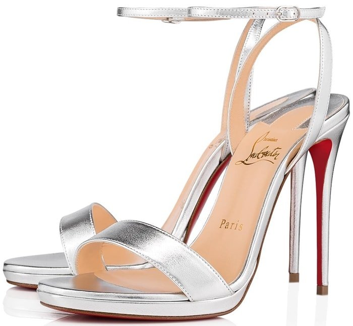 A slim platform and lofty 120mm wrapped stiletto add leg-lengthening lift to Christian Louboutin's Loubi Queen in silver nappa laminata leather