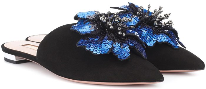 For everyday glamour, we adore these slippers that are crafted in Italy from soft suede in classic black, this pointed-toe pair balance on a signature low mirrored heel and finish with a dimensional sequin-embellished blue hibiscus flower to the toe