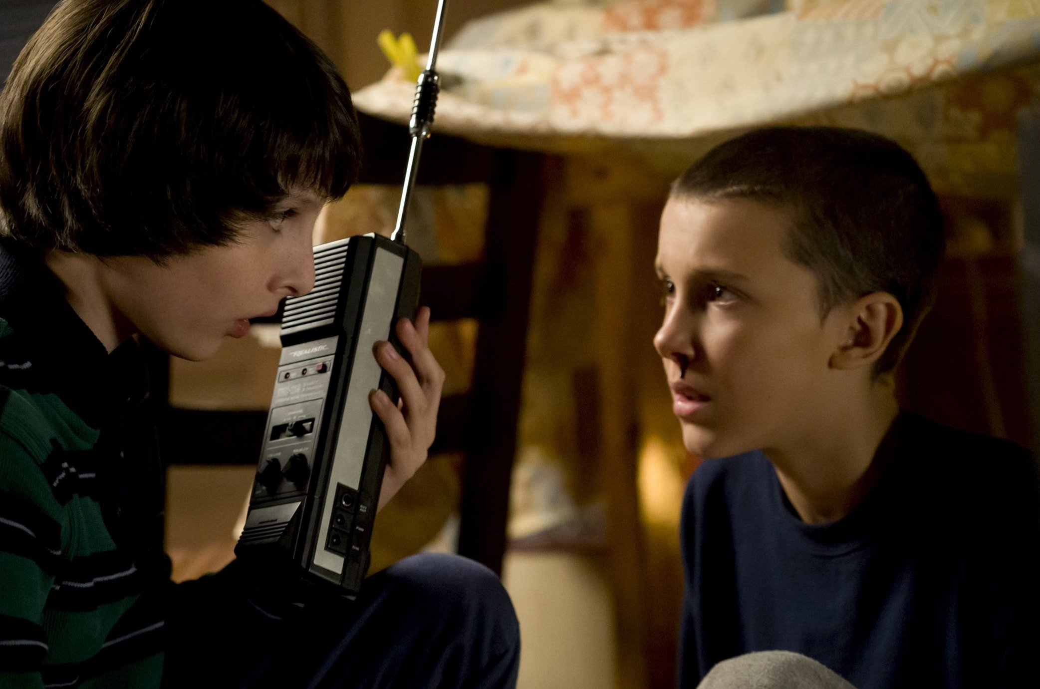 "Finn Wolfhard as Mike Wheeler and Millie Bobby Brown as Eleven / Jane Hopper (""El"") in Stranger Things"