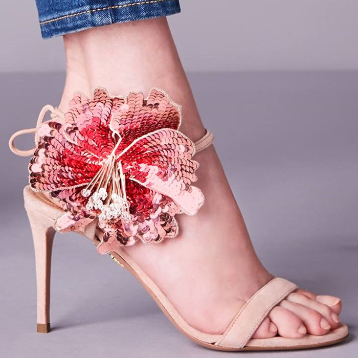Bloom in this floral-embellished sandal that is expertly crafted in Italy from buttery suede in sensitive french rose