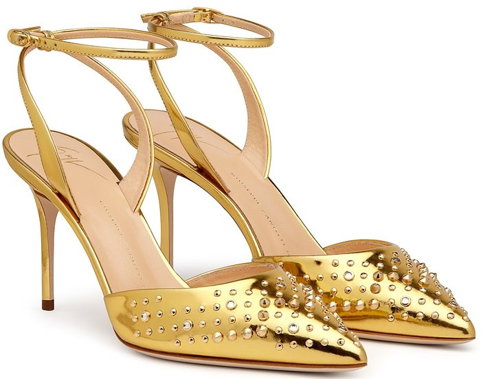 The mirrored golden leather is studded across the pointed toes, with low-slung uppers and a heel-fastening strap creating a streamlined silhouette