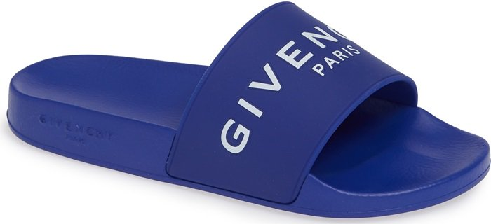 A bold Givenchy logo stamp crosses the wide strap of a cushy, water-friendly rubber slide sandal