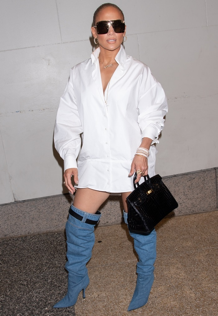 Jennifer Lopez arriving in a white oversized shirt-dress for her interview on MTV's TRL in New York City on July 31, 2018
