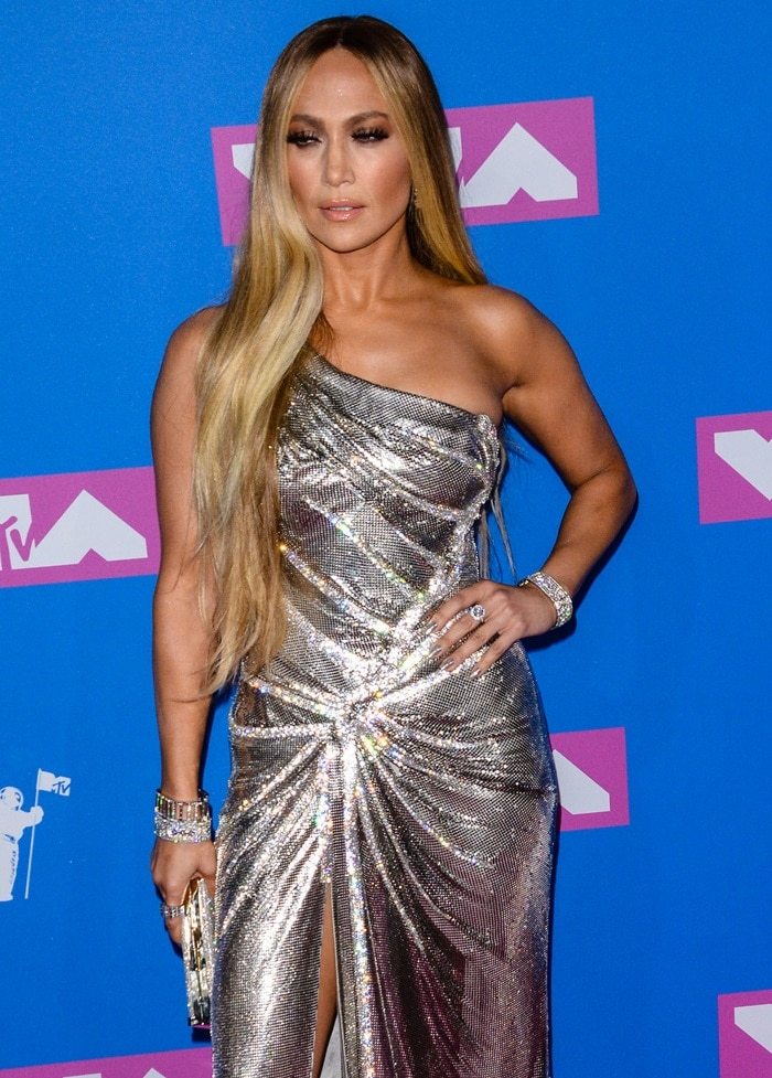 Jennifer Lopez in a custom silver chainmail one-shoulder dress from Versace