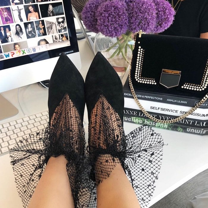 Jimmy Choo's black soft suede Leanne pumps have a bewitchingly feminine disposition