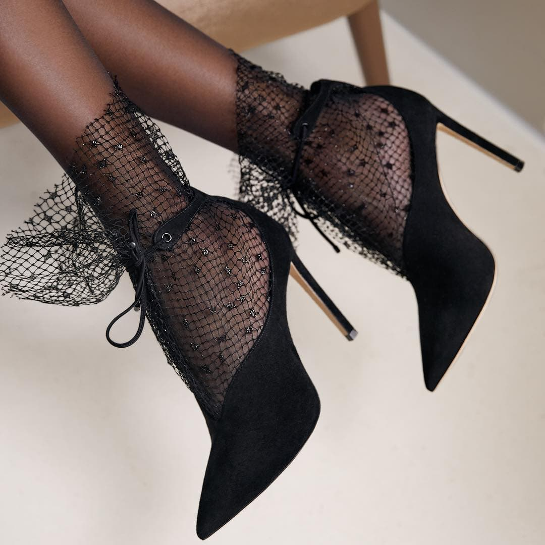 The mesh is trimmed past the ankle leaving its raw edges to create a very modern but elegant style with a rock 'n roll vibe